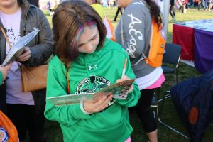 "Hannah, signing a ""Medikidz Explain Playing Sports with Epilepsy"" book!"